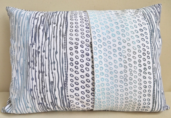 The same cushion showing the fold over opening