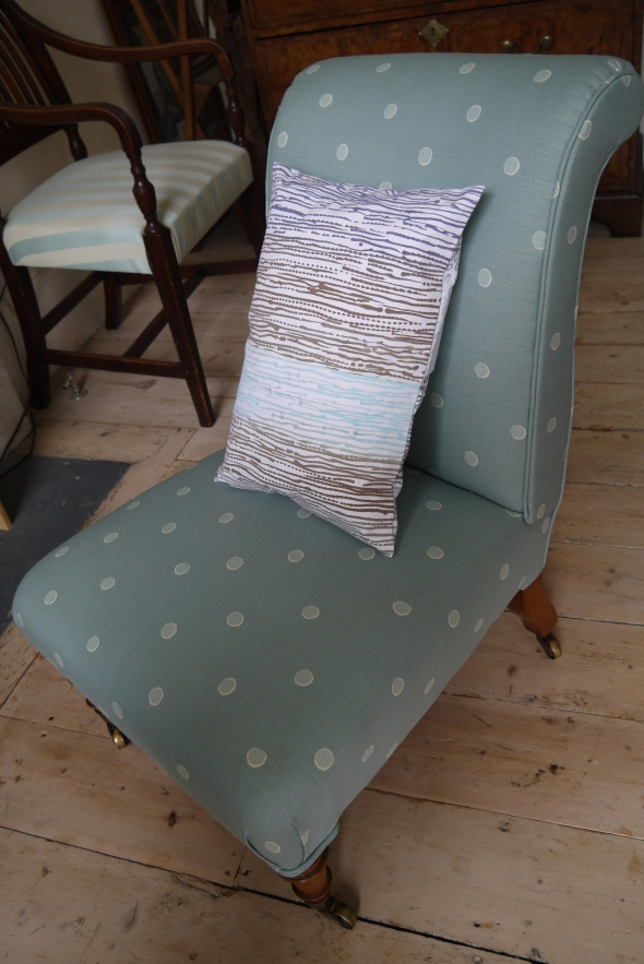 Ombre print cushion on white ticking fabric