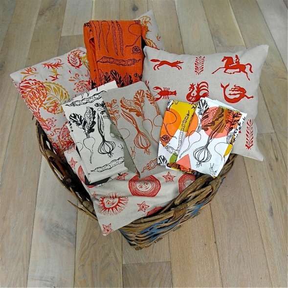 Orange and red textiles in woven basket