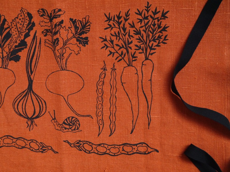 Vegetable detail of orange linen apron