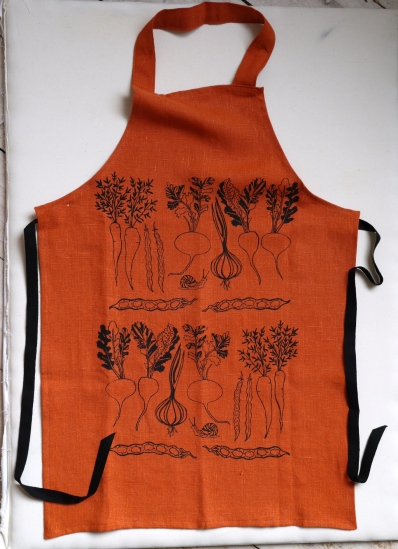 Orange linen apron printed with vegetable design