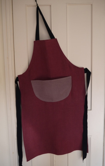 Two colour plain purple linen apron with a pocket